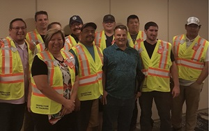 Inspector training graduates class wearing safety vests
