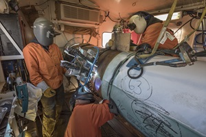 Pipeline welders in welding shack